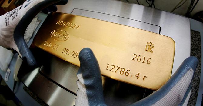 Giá vàng về đáy 2 tuần do đồng USD tăng giá